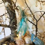 fairy feather angel teal side view