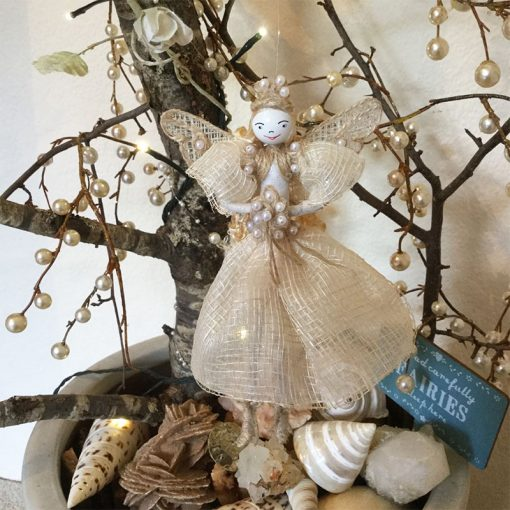 fairy princess tree blue sign sea shells front view natural
