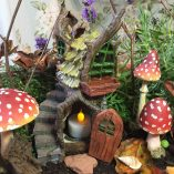 Stump Cottage with Fairy House and tea light