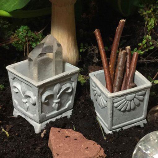 toadstool garden fairy seated on stone