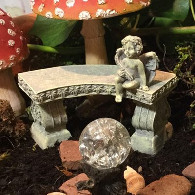 fairy accessory cherub on bench