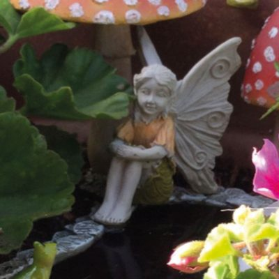 fairy with hands on knees