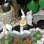 fairy with hands on knees stone bridge